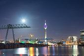 Illuminated Harbour With Rhinetower Of Duesseldorf At Night
