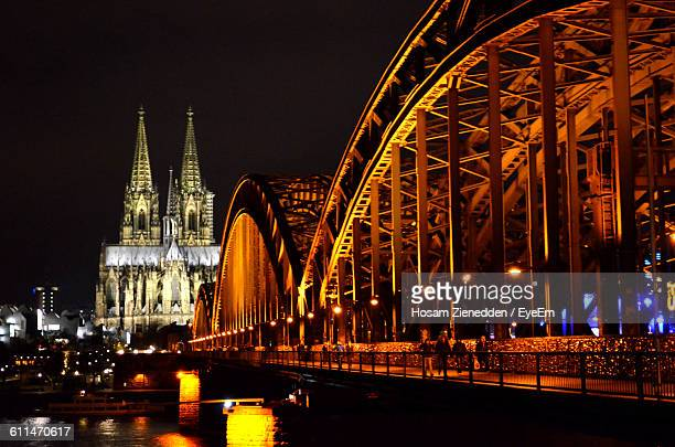 Illuminated Hohenzollern Bridge Over Rhine River With Cologne Cathedral