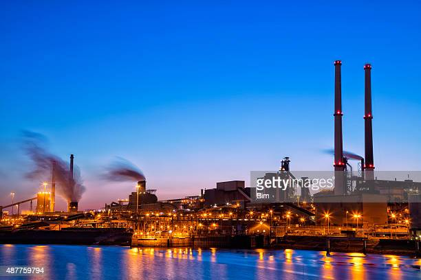 Illuminated Industrial Plant on the River at Night,  Amsterdam, Netherlands