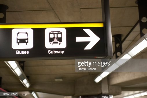 Illuminated information sign in subway platform : Stock Photo