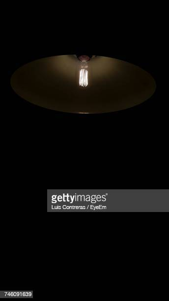 Illuminated Lamp In Darkroom