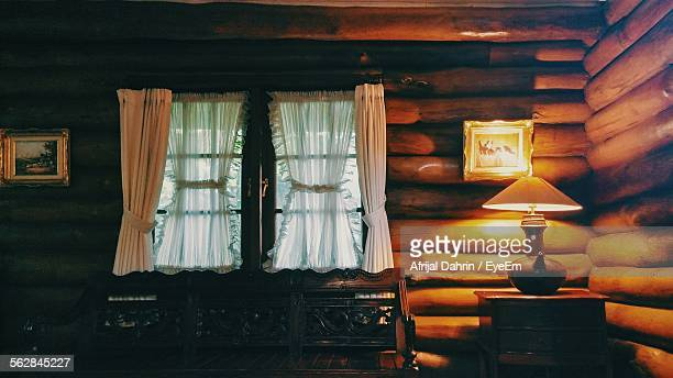 Illuminated Lamp In Log Cabin