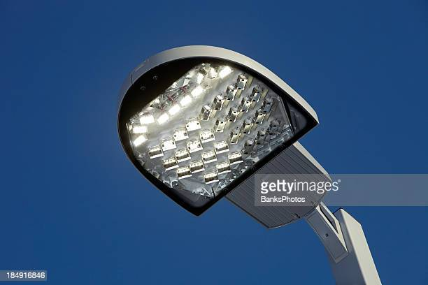 Illuminated LED Streetlight against a Clear Blue Sky