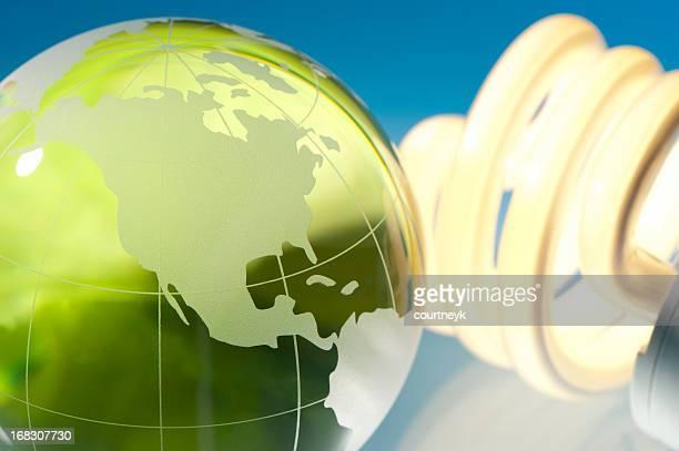 Illuminated light bulb with glass earth globe