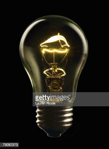 Illuminated lightbulb, close up : Stock Photo