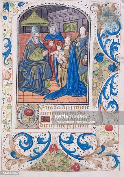 Illuminated manuscript page from 'Tenere et credere me faciat' with illustration of a baby with four adults with a decorative border book of hours...