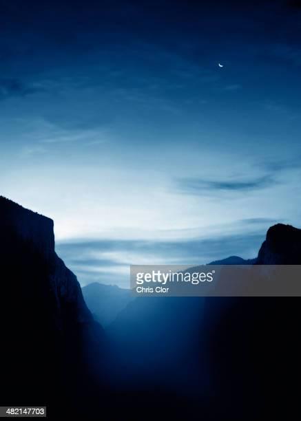 Illuminated mist and mountains