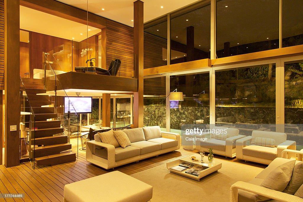 Illuminated Modern Living Room At Night Stock Photo