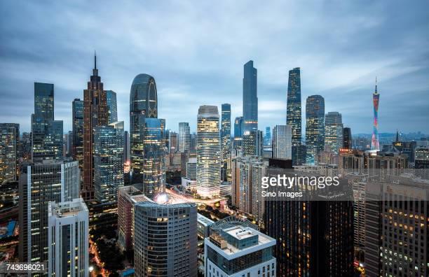 Illuminated modern skyscrapers in financial district at dusk, Zhujiang New Town, Guangzhou, Guangdong, China