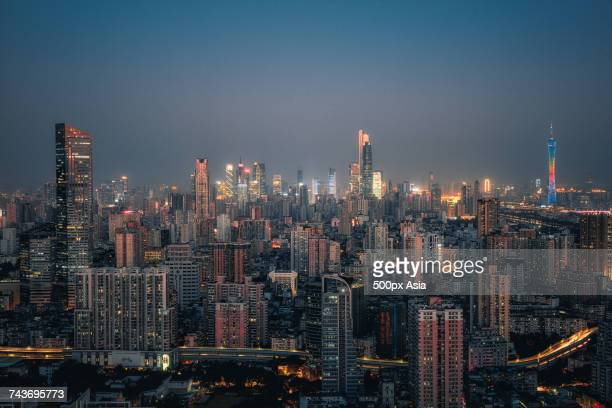 Illuminated modern skyscrapers in financial district at night, Guangzhou, Guangdong, China