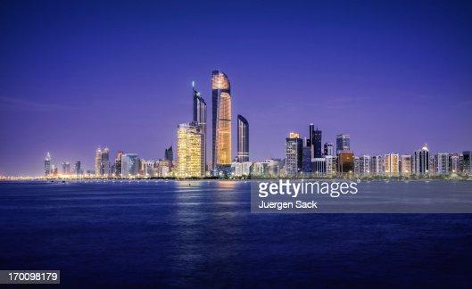 Illuminated nighttime skyline of Abu Dhabi