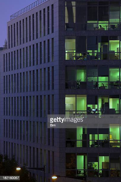 Illuminated office building at dusk