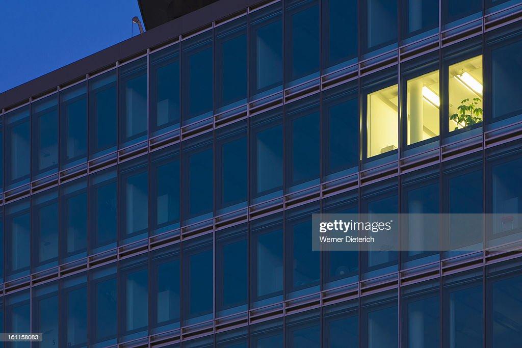 Illuminated office in an office block, Germany