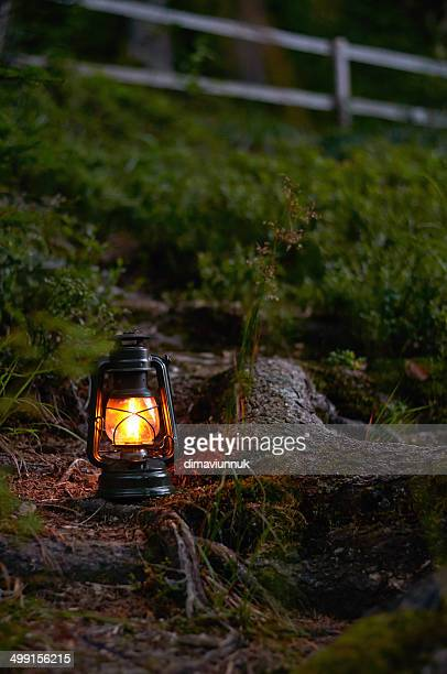 Illuminated oil lamp in field
