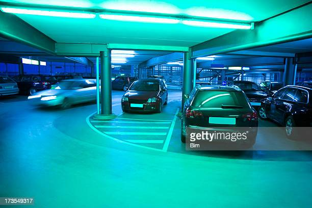Illuminated Parking Garage with Cars