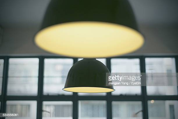Illuminated Pendant Light Hanging From Ceiling