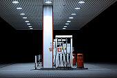 Illuminated petrol station, night
