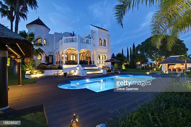 Illuminated pool outside villa