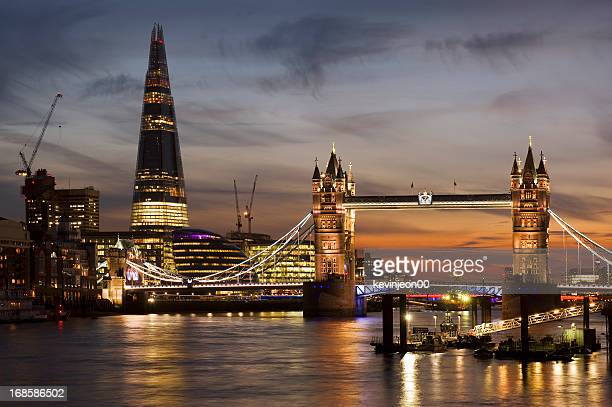 Illuminated riverside photo of London skyline