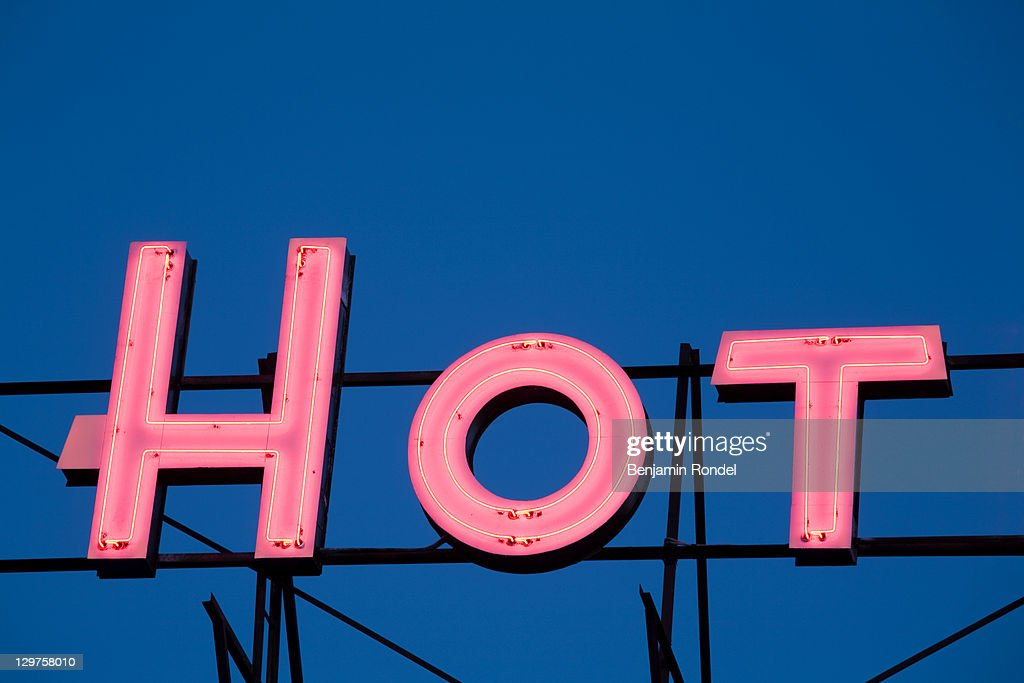 Illuminated sign on roof of hotel : Stock Photo