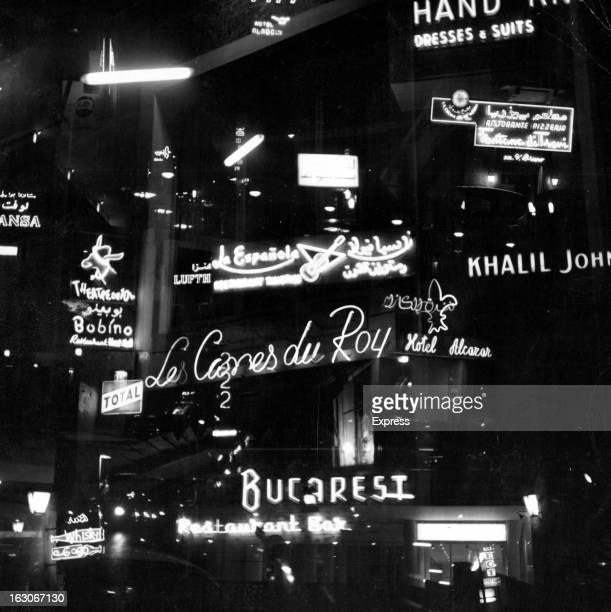 Illuminated signage displayed in many colors and languages across the city to attract the night life crowd in Beirut Lebanon 1955