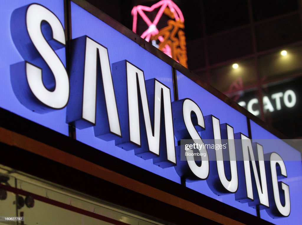 Illuminated signage for Samsung Electronics Co. is displayed outside the company's store in the East Nanjing Road shopping area of Shanghai, China, on Friday, Feb. 1, 2013. China's services industries grew at the fastest pace since August as gains in retailing and construction aid government efforts to drive a recovery in the world's second-biggest economy. Photographer: Tomohiro Ohsumi/Bloomberg via Getty Images