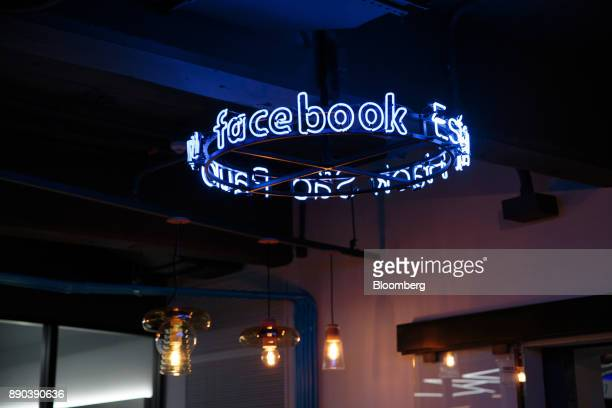 Illuminated signage is displayed at the Facebook Inc Hack Station in Sao Paulo Brazil on Monday Dec 11 2017 The Facebook Hack Station is the first of...