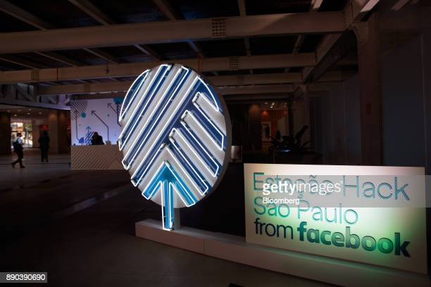 Illuminated signage stands on display at the Facebook Inc Hack Station in Sao Paulo Brazil on Monday Dec 11 2017 The Facebook Hack Station is the...