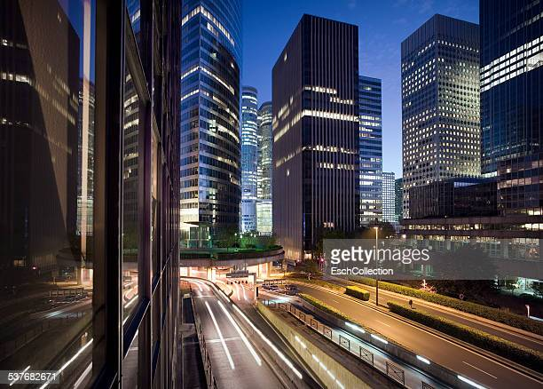 Illuminated skyline of La Defense in Paris at dusk