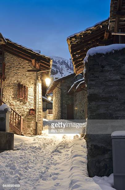 Illuminated street of a rural alpine village