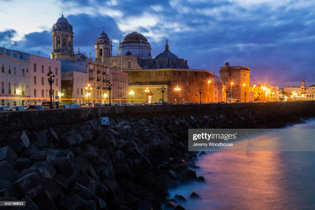 Illuminated streetlights near cathedral on waterfront, Cadiz, Andalusia, Spain