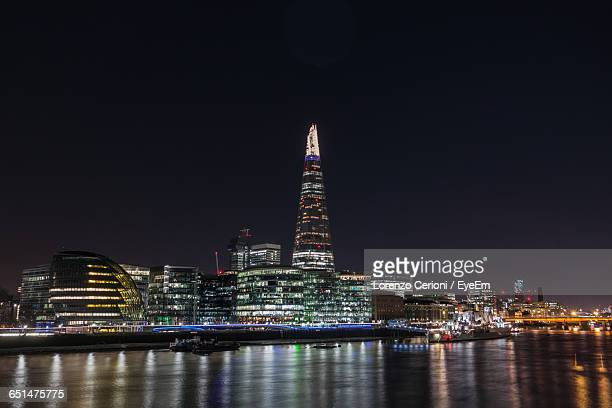 Illuminated The Shard By Thames River Against Clear Sky At Night