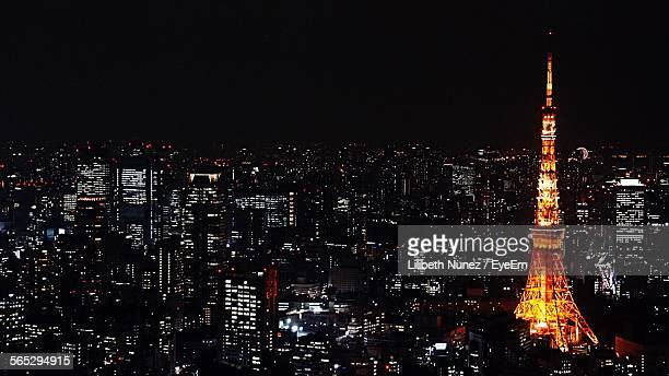 Illuminated Tokyo Tower And Residential District Against Sky At Night