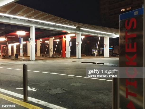Illuminated Toll Booth In City At Night