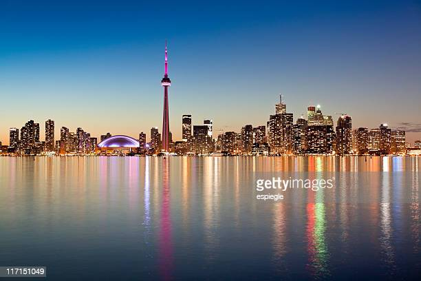 Illuminated Toronto skyline as seen from across the water