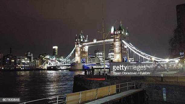 Illuminated Tower Bridge Over Thames River In City