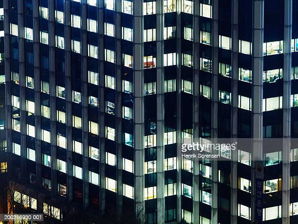 Illuminated windows of high rise building, night