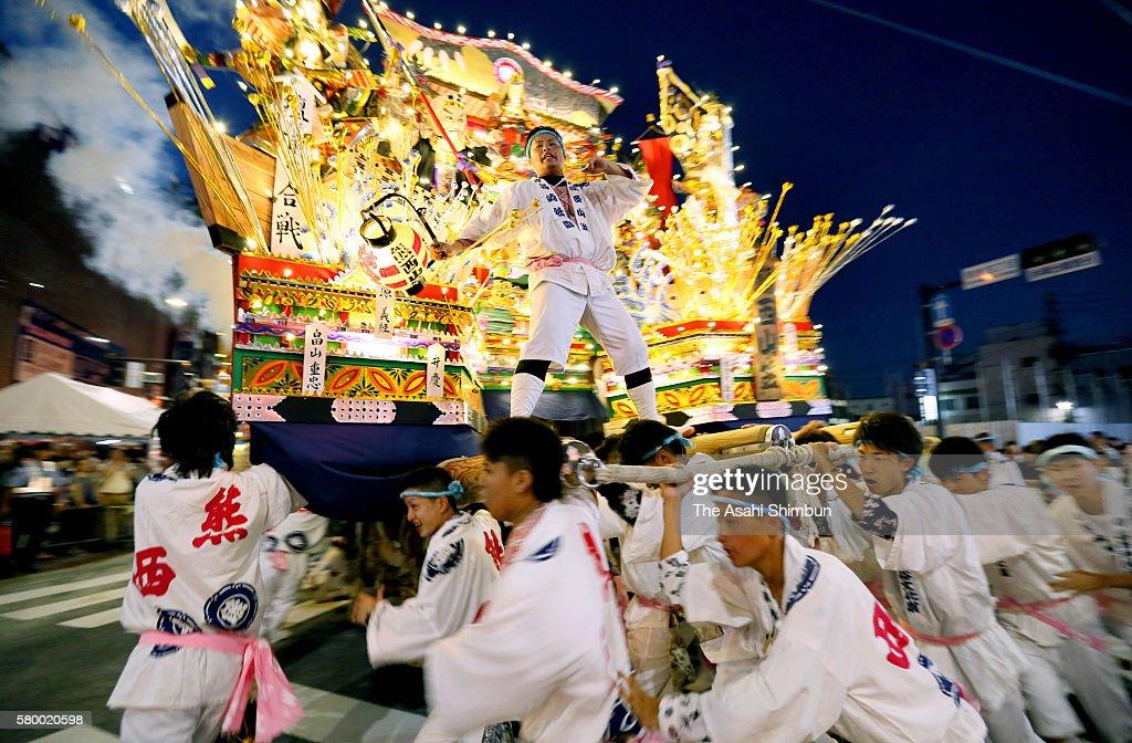 Illuminated 'Yamagasa' float runs at disbandment ceremony of the Kurosaki Gion Yamagasa Festival in front of JR Kurosaki Station on July 22, 2016 in Kitakyushu, Fukuoka, Japan. The annual festival, known as the 'fighting Yamakasa', dates back more than 400 years.