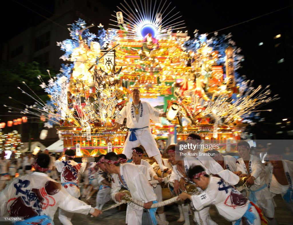 Illuminated 'Yamagasa' float runs during the Kurosaki Gion Yamagasa Festival at JR Kurosaki Station on July 19, 2013 in Kitakyushu, Fukuoka, Japan. The festival will be until July 22.
