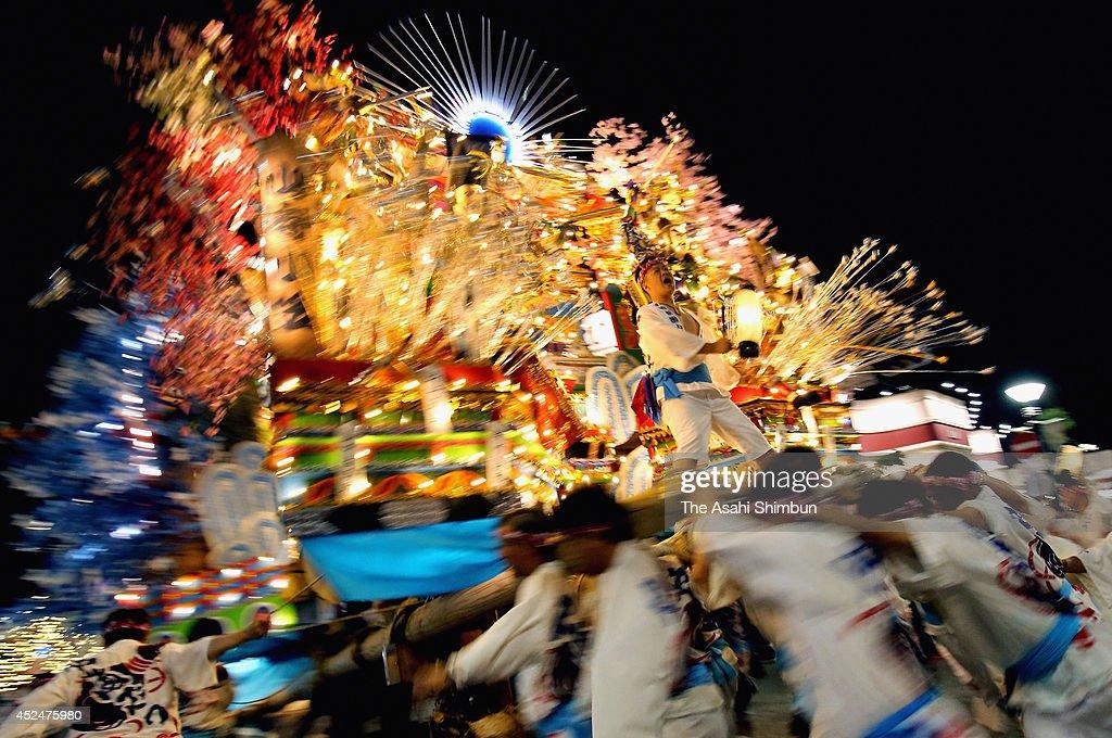 Illuminated 'Yamagasa' float runs during the Kurosaki Gion Yamagasa Festival at JR Kurosaki Station on July 19, 2013 in Kitakyushu, Fukuoka, Japan. The festival will be until July 21.