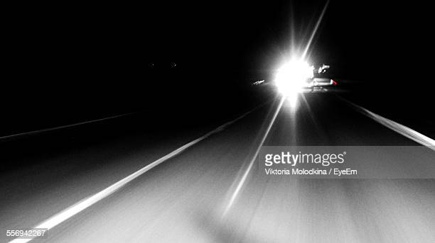 Illuminating Headlight Of Car On Road At Night