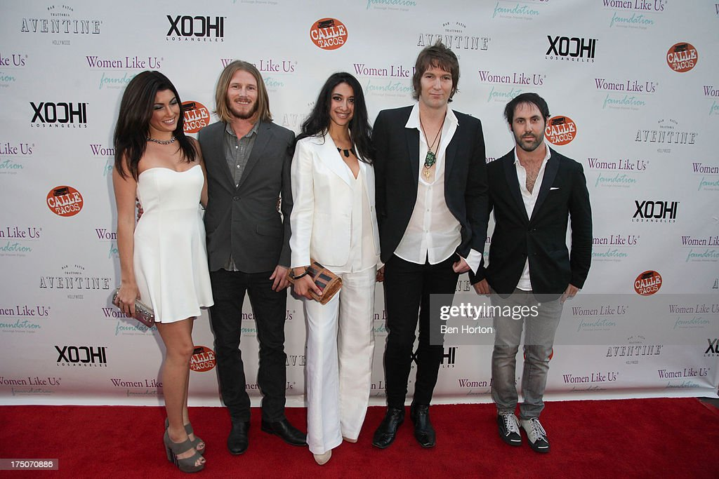 Illumination Road band members Greg Cahill , Chris Ayden and Chad Shlosser with guests attend the Women Like Us Foundation's One Girl at a Time Fundraiser at the Aventine Hollywood on July 30, 2013 in Hollywood, California.