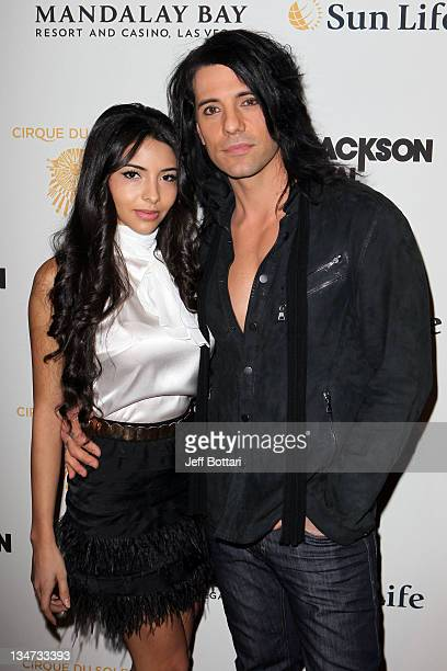 Illusionist Criss Angel and his fiancee Sandra Gonzalez arrive at the Las Vegas premiere of Michael Jackson THE IMMORTAL World Tour by Cirque du...