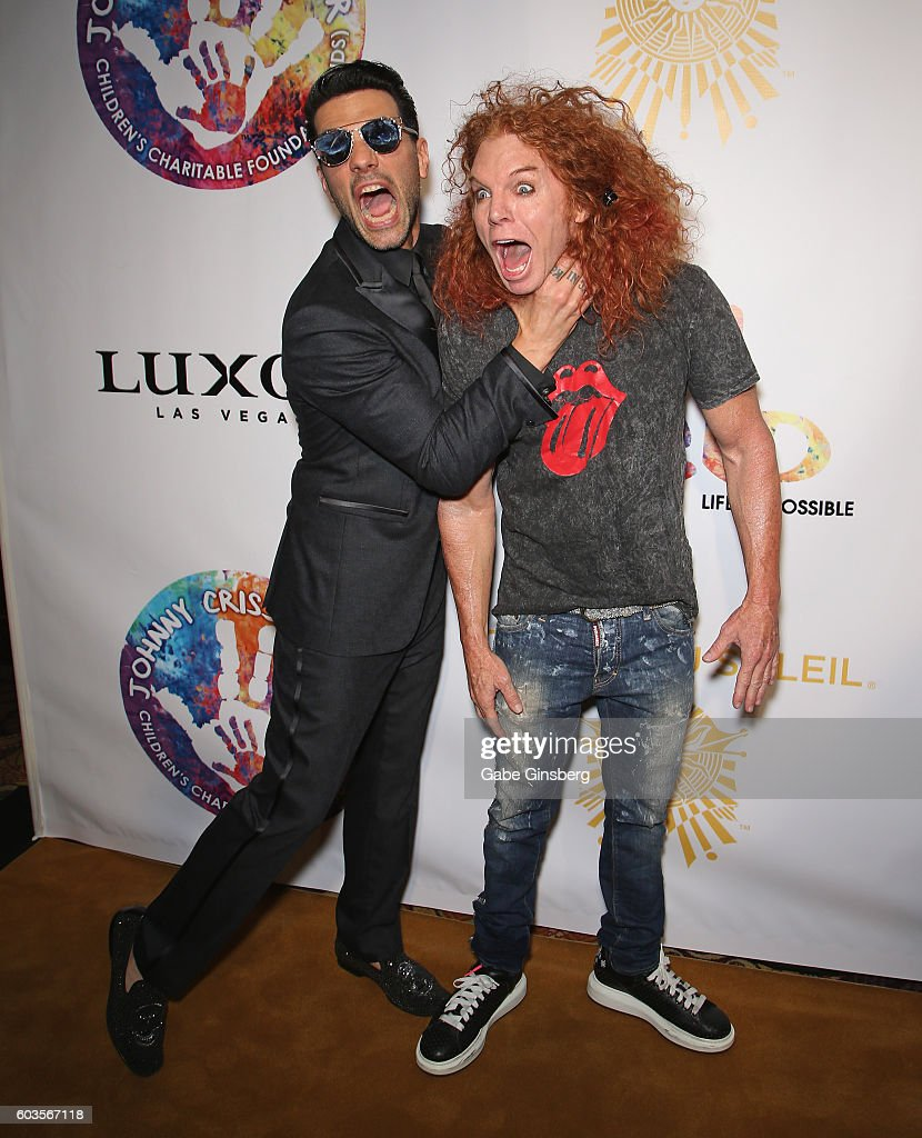 Illusionist Criss Angel (L) jokes around with comedian Carrot Top during Criss Angel's HELP (Heal Every Life Possible) charity event at the Luxor Hotel and Casino benefiting pediatric cancer research and treatment on September 12, 2016 in Las Vegas, Nevada.