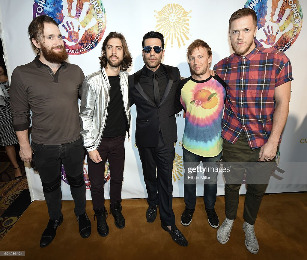 Illusionist Criss Angel (C) poses with (L-R) drummer Daniel Platzman, guitarist Wayne Sermon, bassist Ben McKee and singer/drummer Dan Reynolds of Imagine Dragons at Criss Angel's HELP (Heal Every Life Possible) charity event at the Luxor Hotel and Casino benefiting pediatric cancer research and treatment on September 12, 2016 in Las Vegas, Nevada.