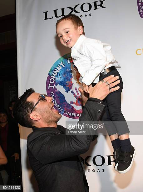 Illusionist Criss Angel tosses his son Johnny Crisstopher Sarantakos in the air at Criss Angel's HELP charity event at the Luxor Hotel and Casino...