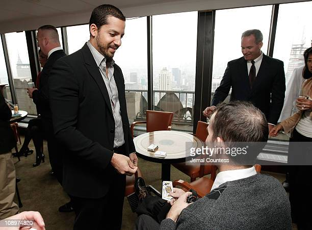 Illusionist David Blaine with Staff Sargent John Faulkenberry attend 'A Salute To Our troops' ceremony hosted by Microsoft Corporation and the United...