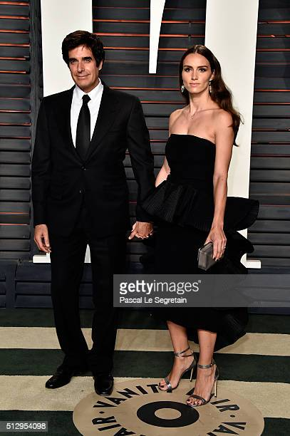 Illusionist David Copperfield and Chloe Gosselin attend the 2016 Vanity Fair Oscar Party Hosted By Graydon Carter at the Wallis Annenberg Center for...