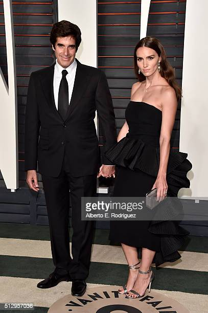 Illusionist David Copperfield and Chloe Gosselin attend the 2016 Vanity Fair Oscar Party hosted By Graydon Carter at Wallis Annenberg Center for the...