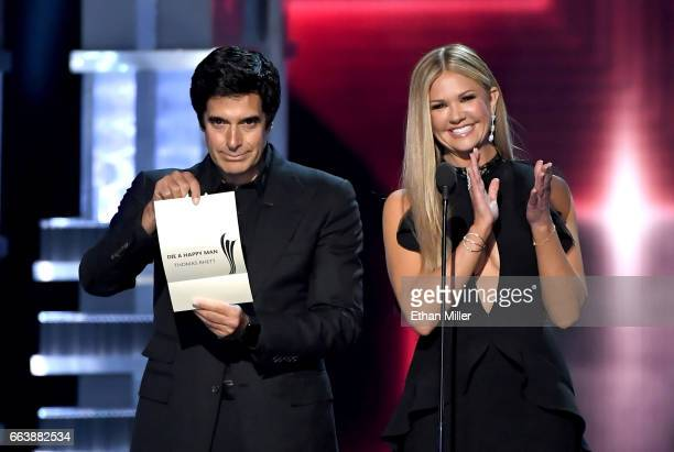 Illusionist David Copperfield and TV personality Nancy O'Dell speak onstage during the 52nd Academy of Country Music Awards at TMobile Arena on April...